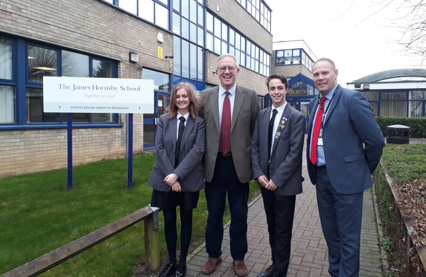 John with Headteacher, Daniel Steel and Head Boy and Girl Mitchell Freeman and Ellis Clark